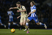 Charlie Taylor, Leeds United defender Craig Mackail-Smith, Brighton striker during the Sky Bet Championship match between Brighton and Hove Albion and Leeds United at the American Express Community Stadium, Brighton and Hove, England on 24 February 2015.