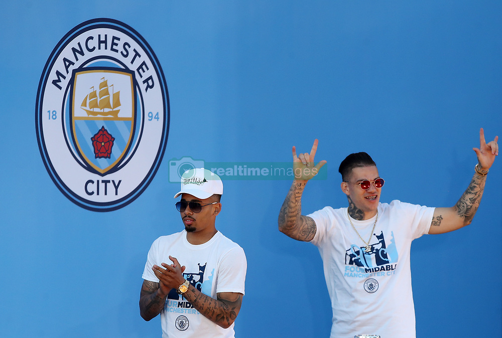 Manchester City's Gabriel Jesus and Ederson walk on stage during the trophy parade in Manchester.