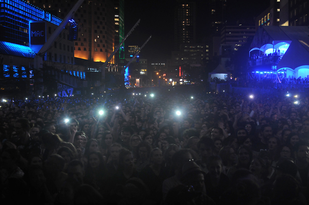 The crowd at Place des Spectacles wait for Half Moon Run as part of Sessions 375. A celebration of Montreal's 375th anniversary featuring free concerts at the Jazz Festival and other festivals. June 2017. (Cult MTL)
