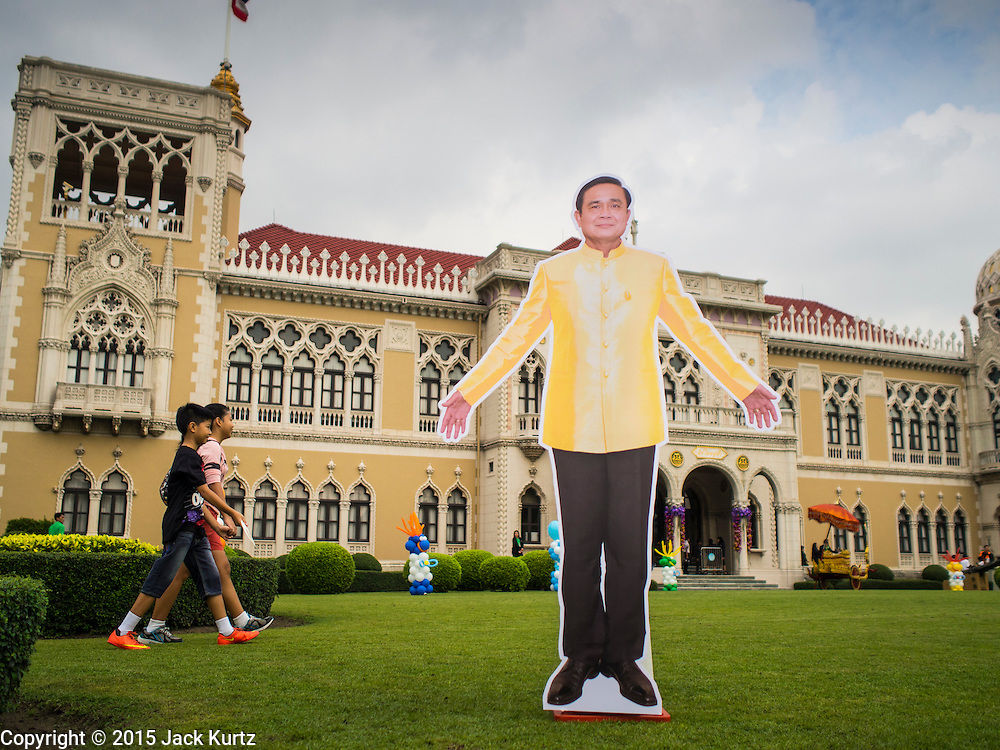 10 JANUARY 2015 - BANGKOK, THAILAND: A life sized cardboard cutout of General Prayuth Chan-ocha, the Prime Minister of Thailand, on the lawn of Government House  during Children's Day festivities in Bangkok. National Children's Day falls on the second Saturday of the year. Thai government agencies sponsor child friendly events and the military usually opens army bases to children, who come to play on tanks and artillery pieces. This year Thai Prime Minister General Prayuth Chan-ocha, hosted several events at Government House, the Prime Minister's office.    PHOTO BY JACK KURTZ