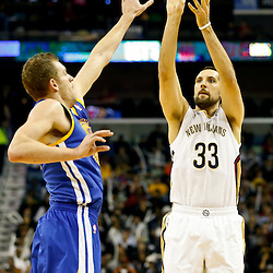 Nov 26, 2013; New Orleans, LA, USA; New Orleans Pelicans power forward Ryan Anderson (33) shoots over Golden State Warriors power forward David Lee (10) during the first quarter of a game at New Orleans Arena. Mandatory Credit: Derick E. Hingle-USA TODAY Sports