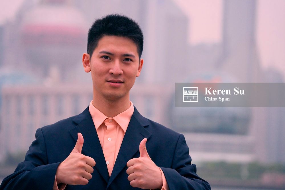 Businessman two thumbs up, Shanghai, China