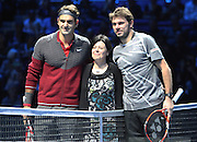 Switzerland's Roger Federer and Switzerland's Stan Wawrinka during the Semi Final of Barclays ATP World Tour 2014 between Switzerland's Roger Federer and Switzerland's Stan Wawrinka, O2 Arena, London, United Kingdom on 15th November 2014 © Pro Sports Images