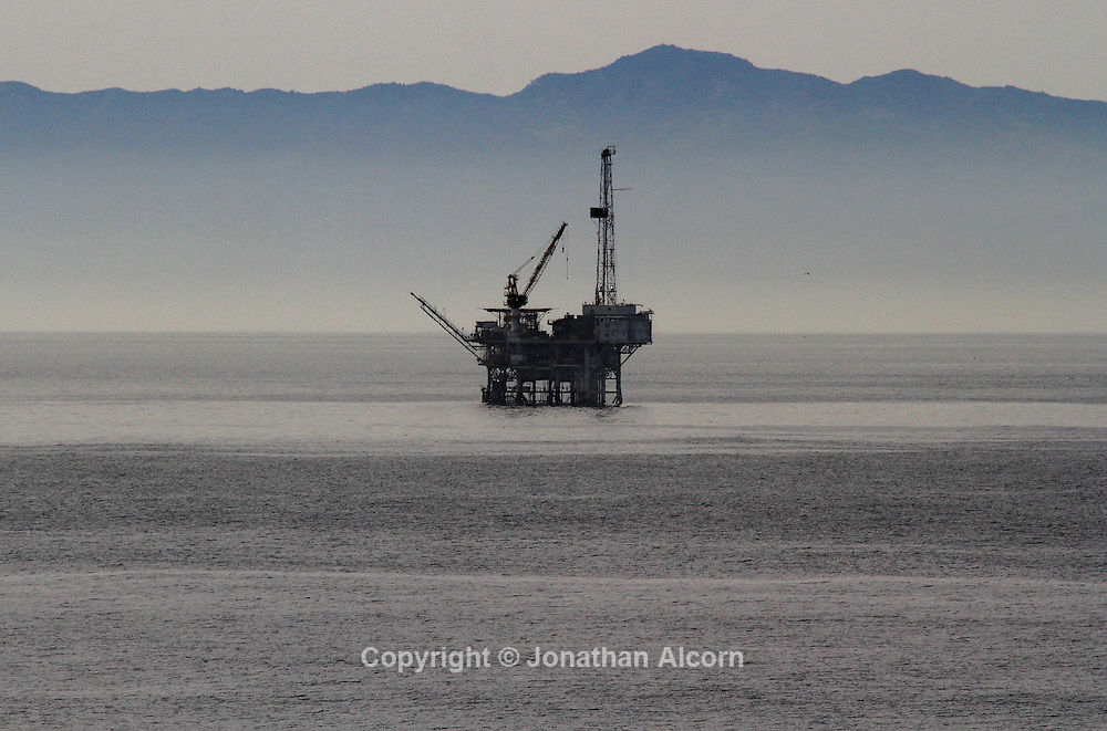 Oil prices are surging and gasoline orices are approaching $4.00 per gallon in California. Pictured, an oil rig offshore from Santa Barbara, California with a Channel Island in the background