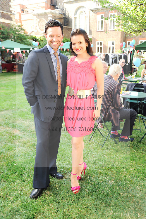 Dancers DARREN BENNETT and LILIA KOPYLOVA at the Lord's Taverners Diamond Jubilee Garden Party held in College Gardens, Westminster Abbey, London on 8th July 2010.