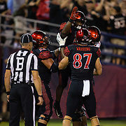 15 September 2018: San Diego State Aztecs running back Juwan Washington (29) celebrates with teammates after scoring on a thirteen yard rushing play in the second quarter. The Aztecs beat the Sun Devils 28-21 at SDCCU Stadium in San Diego, California.