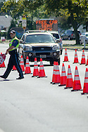 15 Oct. 2016 Forked River USA / Lacey Police manage the traffic for visitors as St Pius X celebrates it's 10th year in their new church with a festival open to all  /  Michael Glenn  / Glenn Images