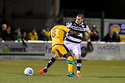 Forest Green Rovers Midfielder, Liam Noble (15) tackles Sutton United Midfielder, Bedsente Gomis (8) during the Vanarama National League match between Sutton United and Forest Green Rovers at Gander Green Lane, Sutton, United Kingdom on 14 March 2017. Photo by Adam Rivers.