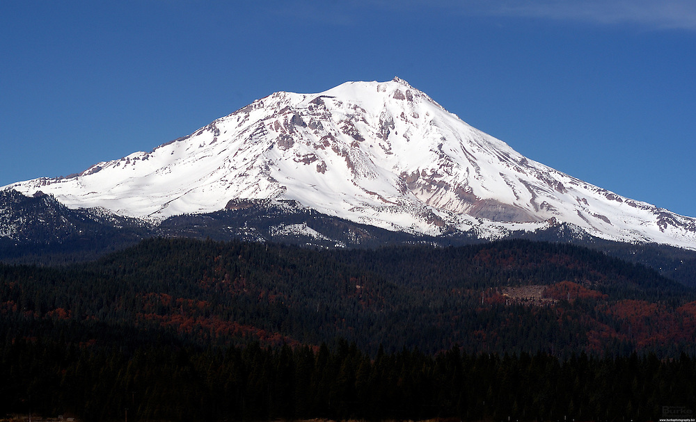 Mt. Shasta in Northern California is a 14,179-foot (4,322 m) stratovolcano, is the second-highest peak in the Cascade Range and the fifth highest peak in California. It is a member in the Cascade Volcanic Arc and is located in Siskiyou County. Mount Shasta stands some 10,000 feet (3,000 m) above the surrounding area and is home to a variety to sports including, mountaineering, hiking, fishing, skiing, show-shoeing, snow and many other activities.  Mt. Shasta is a spiritual place for many also.