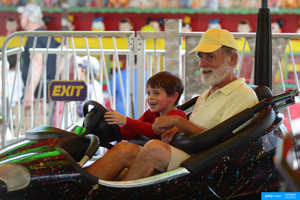 A grandfather and grandson enjoy a ride on the dodgem cars during the Weston Fair, Weston, Connecticut, USA. 28th May 2012. Photo Tim Clayton
