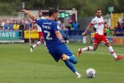 AFC Wimbledon defender Luke O'Neill (2) with a shot on goal during the EFL Sky Bet League 1 match between AFC Wimbledon and Rotherham United at the Cherry Red Records Stadium, Kingston, England on 3 August 2019.