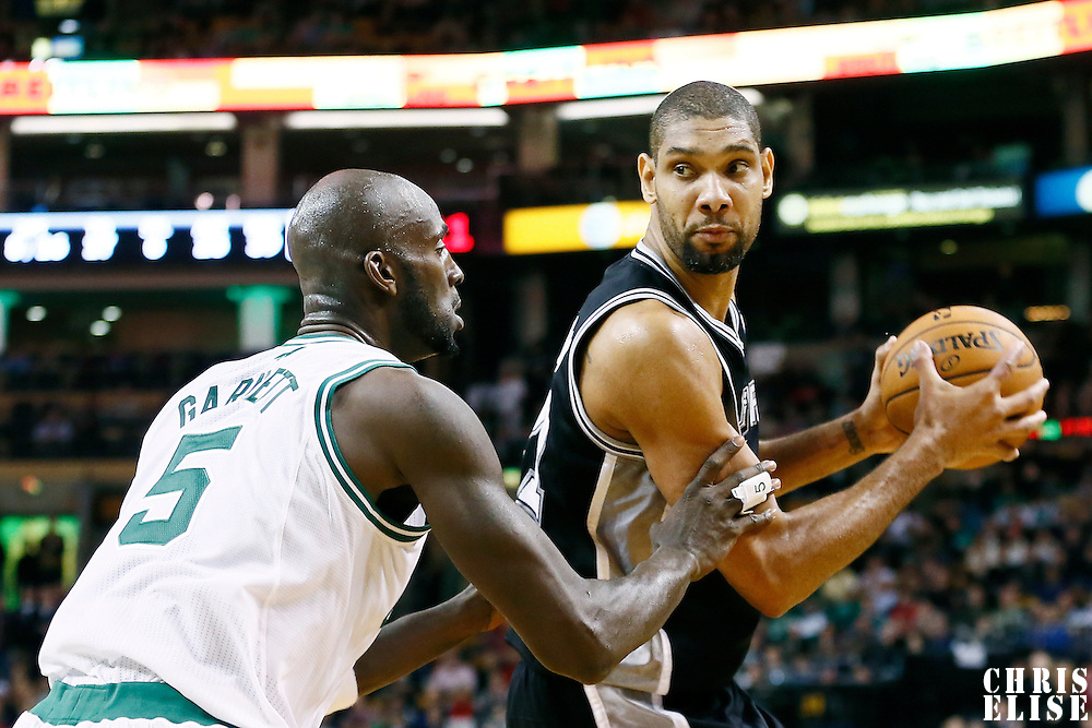 21 November 2012: Boston Celtics power forward Kevin Garnett (5) defends on San Antonio Spurs power forward Tim Duncan (21) during the San Antonio Spurs 112-100 victory over the Boston Celtics at the TD Garden, Boston, Massachusetts, USA.