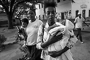 Zanzibar Town, Zanzibar -   2015-03-27  - Mothers leave a NA meeting in Stone Town, Zanzibar on March 27, 2015.  Photo by Daniel Hayduk