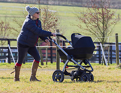 Zara Phillips, pushes the pram of her new born daughter Mia Grace as she attends the Vine and Craven Hunt Barbury Point-to-Point. Barbury, United Kingdom. Sunday, 16th February 2014. Picture by i-Images