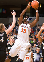 Virginia center Aisha Mohammed (33) shoots past Colorado center Kara Richards (44).  The #16 ranked Virginia Cavaliers women's basketball team defeated the Colorado Buffaloes 77-43 at the John Paul Jones Arena on the Grounds of the University of Virginia in Charlottesville, VA on November 24, 2008.
