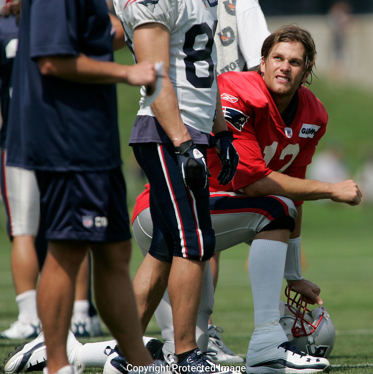 Foxboro, MA - New England Patriots quarterback Tom Brady takes a knee with his helmet off during training camp on Friday August 5, 2011 at the practice fields at Gillette Stadium.   Photo by Matthew Healey