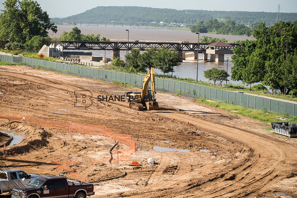 7/13/15 9:08:21 AM -- Major dirt work begins at A Gathering Place for Tulsa. Crews work on storm drainage, the slurry wall and digging the pond. <br /> <br /> Photo by Shane Bevel