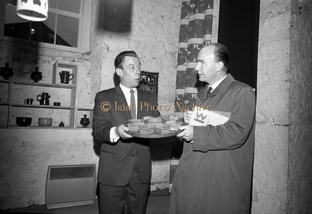Opening of Kilkenny Design Workshop. W.H. Walshe, chairman, presenting a set of hors d'eurves dishes to Dr. P.J. Hillery, Minister for Industry and Commerce, as a gift for Mrs. Hillery.<br /> 15.11.1965