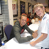 Footballer Kevin Davies signs autographs for fans during a signing session at the Reebok Stadium.<br /> Picture by Paul Currie<br /> 07796 146931