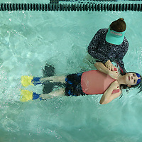Holly Walker helps Lucas leonard, 11, float on his back as part of spring break swim lesson at the North Mississippi Medical Center Wellness Center in Tupelo.