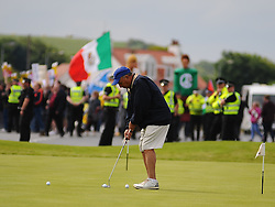 Pictured: Golfers continue playing despite protesters gather to protest against US Presidential candidate Donald Trump as he arrives in Scotland to open his multi-million pound redevelopment of his Turnberry hotel and golf resort.<br /> <br /> <br /> © Dave Johnston/ EEm