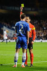 Chelsea Defender Branislav Ivanovic (SRB) is shown a yellow card by referee Pedro Proenca (POR) after fouling PSG Midfielder Blaise Matuidi (FRA) - Photo mandatory by-line: Rogan Thomson/JMP - 07966 386802 - 08/04/2014 - SPORT - FOOTBALL - Stamford Bridge, London - Chelsea v Paris Saint-Germain - UEFA Champions League Quarter-Final Second Leg.