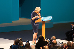 © Licensed to London News Pictures. 04/10/2017. Manchester UK. Theresa May coughing during her speech on the third & final day of the Conservative Party Conference today in Manchester. Photo credit: Andrew McCaren/LNP