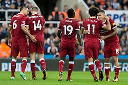 NEWCASTLE-UPON-TYNE, ENGLAND - Sunday, October 1, 2017: Liverpool's Philippe Coutinho Correia is congratulated by Mohamed Salah after scoring his sides first goal during the FA Premier League match between Newcastle United and Liverpool at St. James' Park. (Pic by Paul Greenwood/Propaganda)