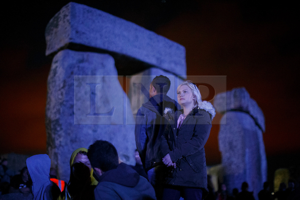 © Licensed to London News Pictures. 20/06/2015. Salisbury, UK. People prepare for the summer solstice dawn celebrations as druids, pagans and revellers gathered the night before the Summer Solstice sunrise at Stonehenge on June 20, 2015 in Wiltshire, England. Thousands of revellers gather at the 5,000 year old stone circle in Wiltshire to see the sunrise on the Summer Solstice dawn. The solstice sunrise marks the longest day of the year in the Northern Hemisphere. Photo credit: Tolga Akmen/LNP