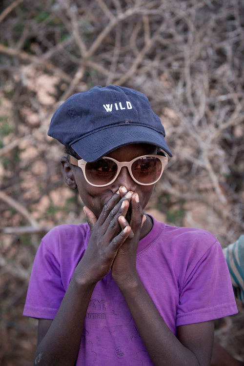 A Samburu boy tries on our cap and sunglasses for size