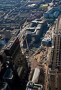 Nederland, Zuid-Holland, Rotterdam, 20-03-2009; Stationsplein, aanleg Rotterdam Centraal, nieuw station ook wel OV-terminal (of OV-knooppunt). Vervanging en uitbreiding van het oude Centraal Station (rechts)  was noodzakelijke omdat in de toekomst ook HSL-Zuid en RandstadRail van het nieuwe vervoersknooppunt gebruik zullen maken. Linksonder Nationale Nederlanden, na het plein het Groothandelsgebouw .  Air view on the center of Rotterdam, the replacement and enlargement of the old Central Station of Rotterdam, in connection with the HSR. Black high-rise bulding is the head office of the assurance company Nationale Nederlanden (National Netherlands). .Swart collectie, luchtfoto (toeslag); Swart Collection, aerial photo (additional fee required).foto Siebe Swart / photo Siebe Swart