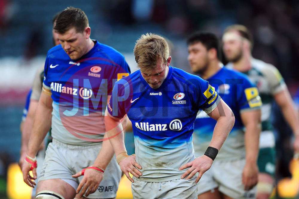 Saracens players look dejected after the match - Mandatory byline: Patrick Khachfe/JMP - 07966 386802 - 20/03/2016 - RUGBY UNION - Welford Road - Leicester, England - Leicester Tigers v Saracens - Aviva Premiership.