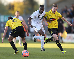 Hereford United's Kevin Krans breaks through Burton Albion's Phil Edwards and Burton Albion's Lee Bell - Photo mandatory by-line: Matt Bunn/JMP - Tel: Mobile: 07966 386802 10/11/2013 - SPORT - FOOTBALL - Pirelli Stadium - Burton upon Trent - Burton Albion v Hereford United - FA Cup