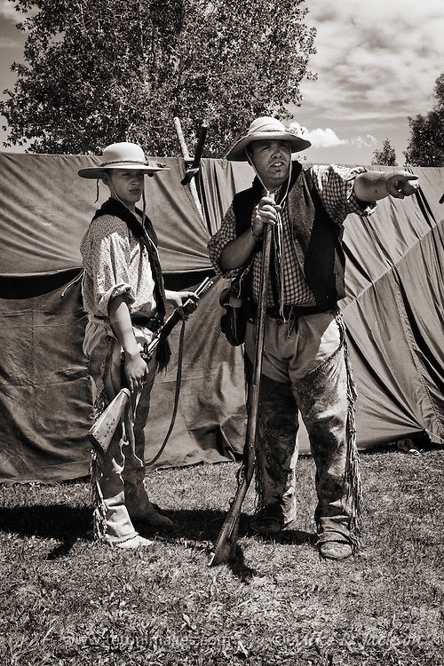 Trapper giving instructions to his son at a Mountain Man Rendezvous at Pinedale, WY.