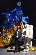 Garden City, New York, USA. May 23, 2019. ANDREW CHAIKIN, best-selling author of A Man on the Moon: The Voyages of the Apollo Astronauts, poses next to the genuine Lunar Module LM-13, built for cancelled Apollo 18 mission and used in HBO miniseries From the Earth to the Moon, which was mainly based on his book. Chaikin talked about growing up on Long Island during the Apollo space program and interviewing Apollo astronauts, at event during the Cradle of Aviation Museum celebration of 50th Anniversary of Apollo 11.