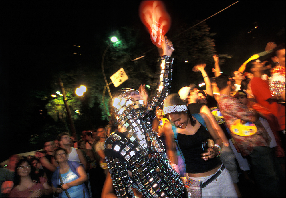 Brazil,Sao Paolo,Praca De Republica.Gay Festival..motion blurred dancer in chain mail dress