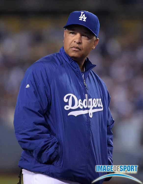 Apr 13, 2016; Los Angeles, CA, USA; Los Angeles Dodgers manager Dave Roberts reacts during a MLB game against the Arizona Diamondbacks at Dodger Stadium. The Dodgers defeated the Diamondbacks 3-1.