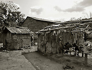 Near Hato Mayor del Rey, Dominican Republic- Workers communities' known as bateyes, such as this very small unnamed batey near the 10 mile marker outside Hato Mayor del Rey, Dominican Republic, often lack adequate housing, medical services, and other basic sanitary services. (Photo by Robert Falcetti)