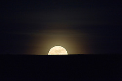 "© under license to London News Pictures. .Photos by Ian Forsyth. March 19, 2011..A full moon rises over Huntcliff at Saltburn by the Sea in Cleveland that today will appear to be the biggest in almost 20 years. ..Called a ""perigee moon,""  this moon rise is a rare celestial event that occurs when the moon reaches the closest possible point of its orbit around the earth, about 212,000 miles away...Photo credit should read Ian Forsyth/LNP"