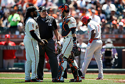 SAN FRANCISCO, CA - JUNE 26: MLB umpire Doug Eddings #88 talks to Johnny Cueto #47 of the San Francisco Giants and Buster Posey #28 after Maikel Franco #7 of the Philadelphia Phillies was hit by a pitch during the fourth inning at AT&T Park on June 26, 2016 in San Francisco, California.  (Photo by Jason O. Watson/Getty Images) *** Local Caption *** Doug Eddings; Johnny Cueto; Buster Posey; Maikel Franco