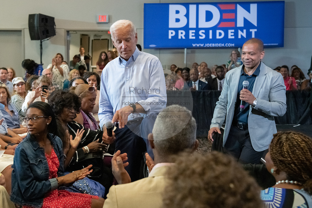 Former Vice President Joe Biden steps over the crowd barrier into the audience after learning that Felicia Sanders, the survivor of the AME church shooting was in the crowd during a town hall meeting at the International Longshoreman's Association Hall July 7, 2019 in Charleston, South Carolina.