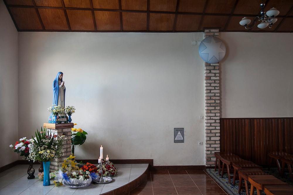 This statue of the Virgin Mary is in the Apparitions Chapel at the Shrine of Our Lady of Sorrows in Kibeho, Rwanda. The chapel is where the three young visionaries slept when the building was a dorm. The Mary statue is where Alphonsine Mumureke's bed was; Alphonsine was the first visionary, back on November 28, 1981.<br /> <br /> This is the only sanctioned Marian sanctuary in Africa. Kibeho's overseers and the Rwandan government hope this place will become a top tourism site. The Virgin Mary appeared here in 1981to three young women, one of whom still lives near the church grounds.<br /> <br /> Photographed on Sunday, October 26, 2014.<br /> <br /> Photo by Laura Elizabeth Pohl