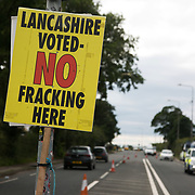 Anti-fracking  activists and protesters outside the gates of Quadrilla's fracking site June 31st, Lancashire, United Kingdom. The struggle against fracking in Lancashire has been going on for years. The fracking company Quadrilla is finally ready to bring in a drill tower to start drilling. Fracking is a highly disputed and and destructive way of extracting gas and locals and environmental expert are highly critical of the procedures. Fracking is a destructive and potential dangerous and highly contentious method of extracting gas and this site will be the first of many in the United Kingdom reaching miles out under ground.