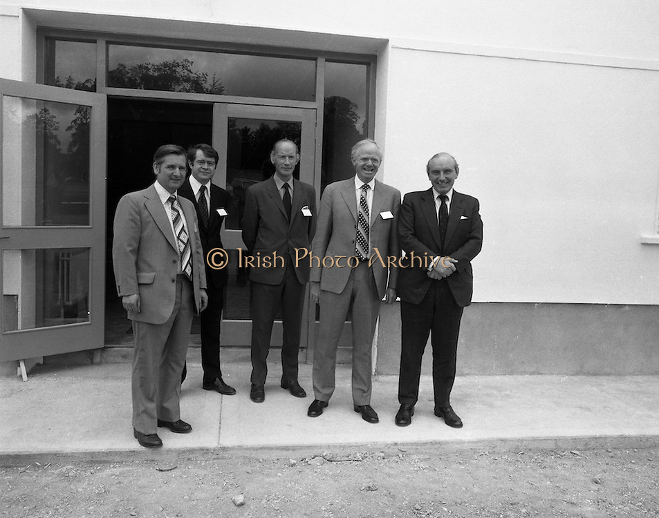 New Bottling plant for D.E.Williams..1975..19.06.1975..06.19.1975..19th June 1975..The Minister for Justice, Mr Patrick Cooney TD, officially opened the new one and a half million gallon per annum soft drink facility at Tullamore,Co Offaly. The new plant represents an investment of over a quarter million pounds by the Williams Group. It is hoped that this investment will create further employment for the area...Pictured at the doors of the new £¼ facility were (L-R), Mr W J Ralph,Managing Director, D E Williams Ltd, Mr M J Murphy, Director, Williams Group, Tullamore Ltd, Mr P V Egan,Technical Director, D E Williams, Mr Edmund Williams,Group Managing Director and the Minister for Justice, Mr Patrick Cooney.