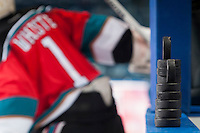KELOWNA, CANADA - DECEMBER 6: Practice pucks are stacked on the boards for the warm up between the Kelowna Rockets and the Prince Albert Raiders on December 6, 2014 at Prospera Place in Kelowna, British Columbia, Canada.  (Photo by Marissa Baecker/Shoot the Breeze)  *** Local Caption ***