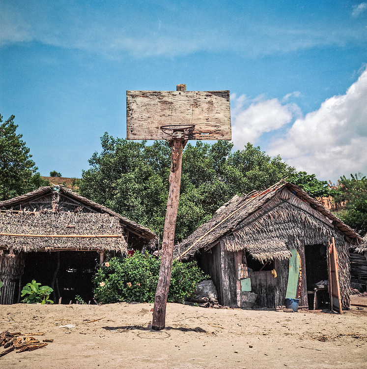 A home made basketball hoop on the beach in front of wooden huts in a small village in Camarines Sur, Bicol Province, 2008.