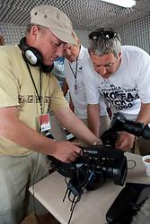 Television cameramen checking equipment. Korea Match Cup 2009, Gyeonggi-do, Korea. 2 June 2009.