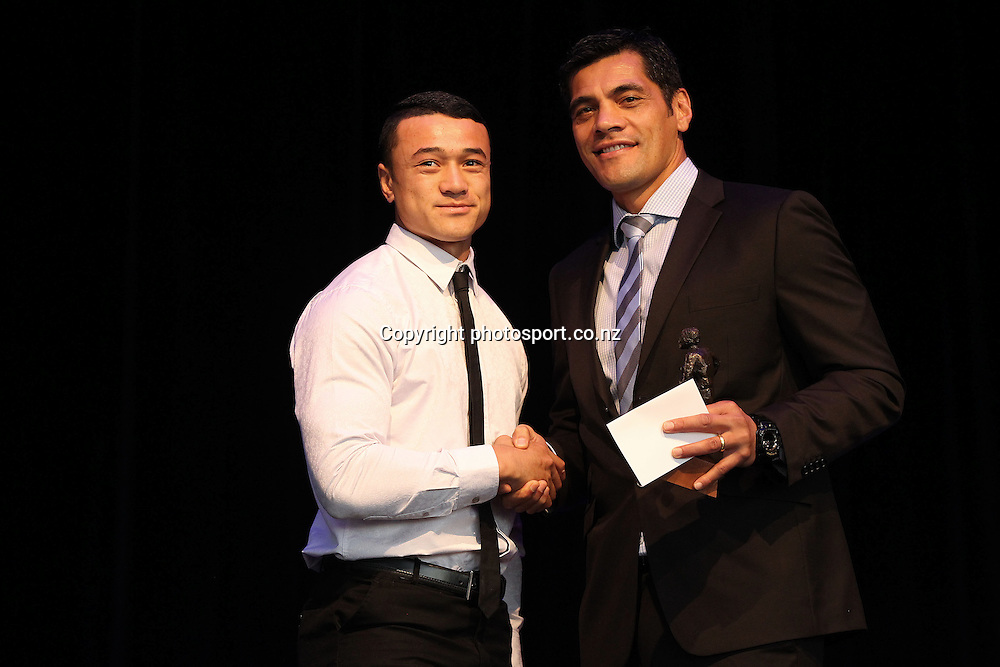Kiwi's coach Steve Kearney presents the award for Domestic Player of the Year 18's to Paul Ulberg at the NZRL Rugby League Awards 2013 at Giltrap Prestige, Grey Lynn, Auckland on Monday, December 9, 2013. Photo: Fiona Goodall/photosport.co.nz