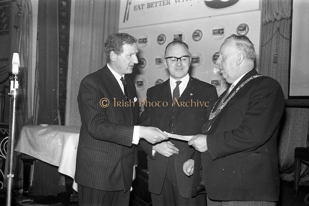 26/03/1963<br /> 03/26/1963<br /> 26 March 1963<br /> M and P Hanlon Ltd. seminar on frozen foods at the Gresham Hotel, Dublin. Mr. F. hardy, managing Director, M and P Hanlon Ltd., sole distributers for Birds-Eye products in Ireland, presenting a docket for a weeks supply of frozen foods to the Lord Mayor of Dublin, Alderman J.J. O'Keeffe T.D., for donation to the National Medical Rehabilitation centre, Dun Laoghaire. Centre is Mr. Dermot O'Flynn, member of the Committee of Management of the Centre.