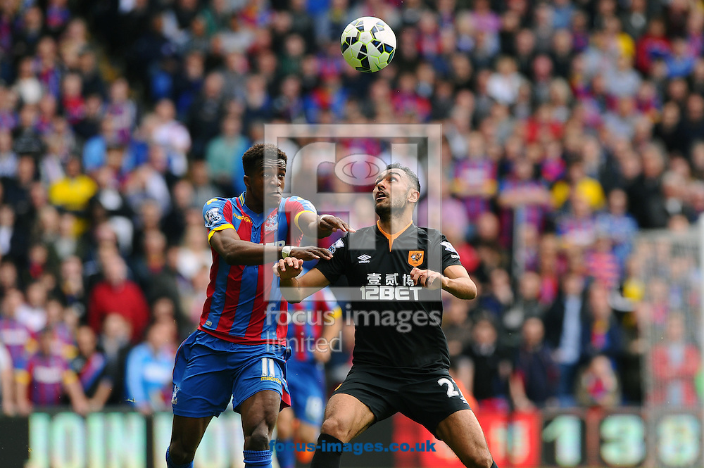 Wilfried Zaha of Crystal Palace (left) and Ahmed Elmohamady of Hull City (right) battle for the ball during the Barclays Premier League match at Selhurst Park, London<br /> Picture by Seb Daly/Focus Images Ltd +447738 614630<br /> 25/04/2015